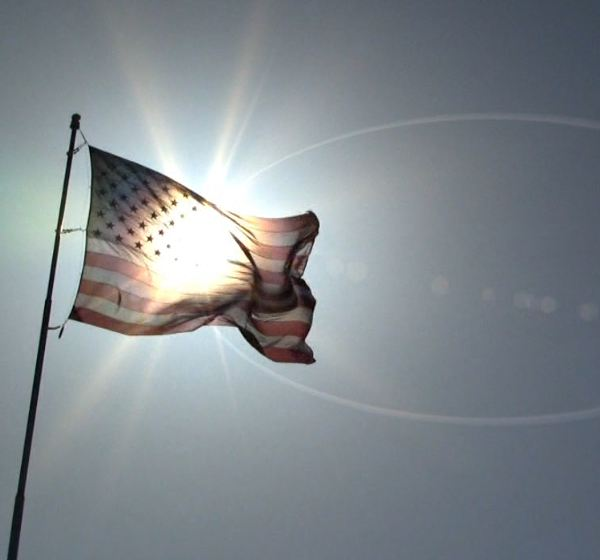 US Flag and Sun Flare Motion HD